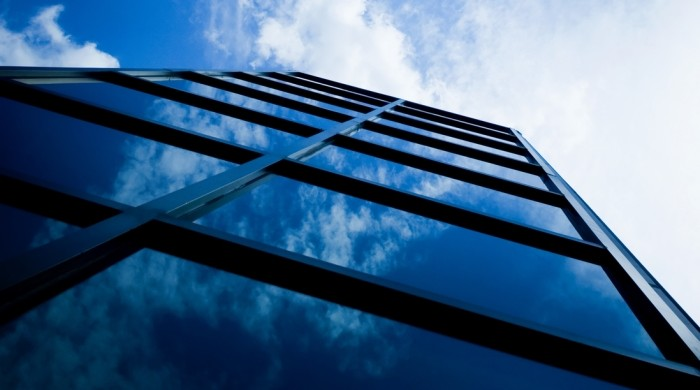 Skyscraper with reflection of clouds in windows